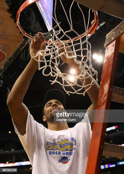 Josh Shipp of the UCLA Bruins cuts down the net after defeating the Stanford Cardinal 67-64 in the championship game of the 2008 Pacific Life Pac-10...