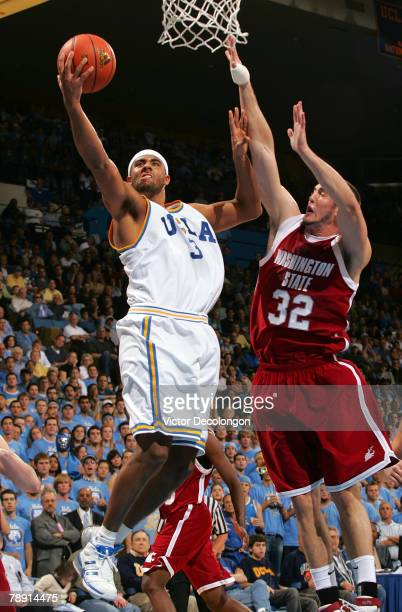 Josh Shipp of the UCLA Bruins lays up a shot against Daven Harmeling of the Washington State University Cougars in the first half during their NCAA...