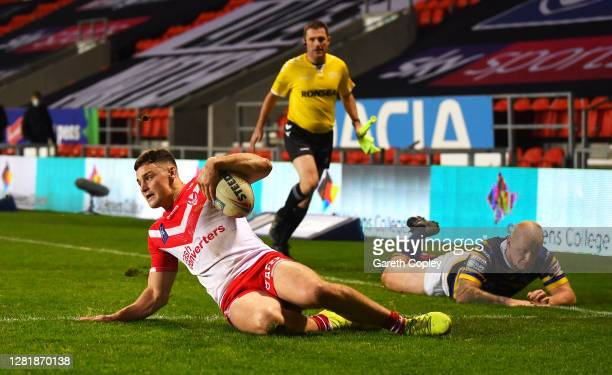 Josh Simm of St Helens scores a try during the Betfred Super League match between St Helens and Leeds Rhinos at Totally Wicked Stadium on October 23,...