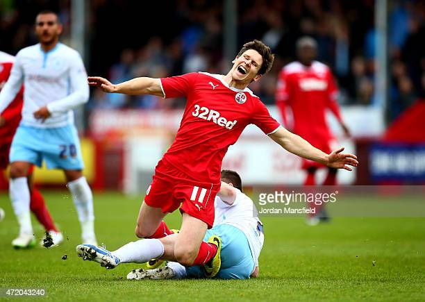 Josh Simpson of Crawley is tackled by John Fleck of Coventry during the Sky Bet League One match between Crawley Town and Coventry City at The...