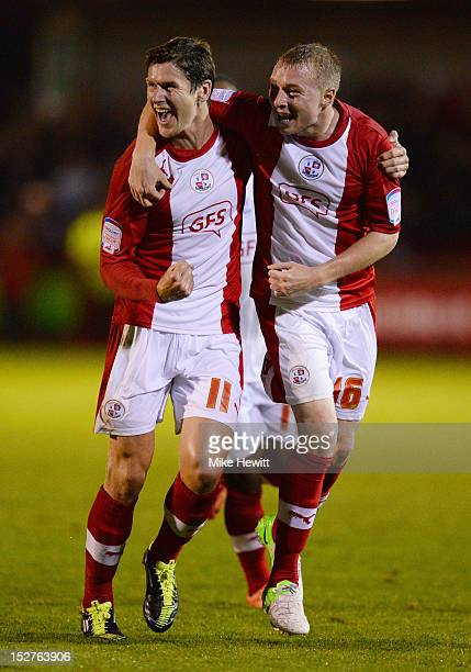 Josh Simpson of Crawley Town celebrates with Nicky Adams as he scores their first goal during the Capital One Cup Third Round match between Crawley...