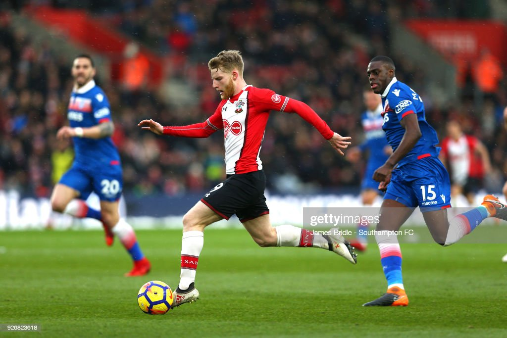 Josh Sims of Southampton FC (left) makes a run down the wing against Stoke City's Bruno Martins Indi (right) during the Premier League match between Southampton and Stoke City at St Mary's Stadium on March 3, 2018 in Southampton, England.