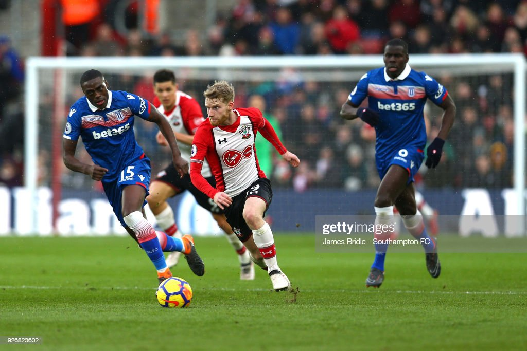 Josh Sims of Southampton FC (middle) takes on Bruno Martins Indi (left) and Kurt Zouma (right) during the Premier League match between Southampton and Stoke City at St Mary's Stadium on March 3, 2018 in Southampton, England.