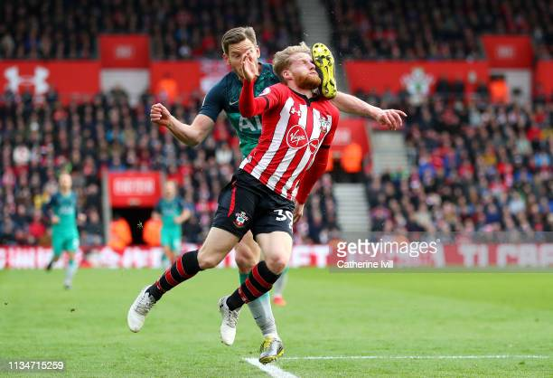 Josh Sims of Southampton is challenged by Jan Vertonghen of Tottenham Hotspur during the Premier League match between Southampton FC and Tottenham...