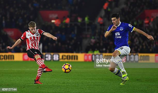 Josh Sims of Southampton shoots while Gareth Barry of Everton attempts to block during the Premier League match between Southampton and Everton at St...