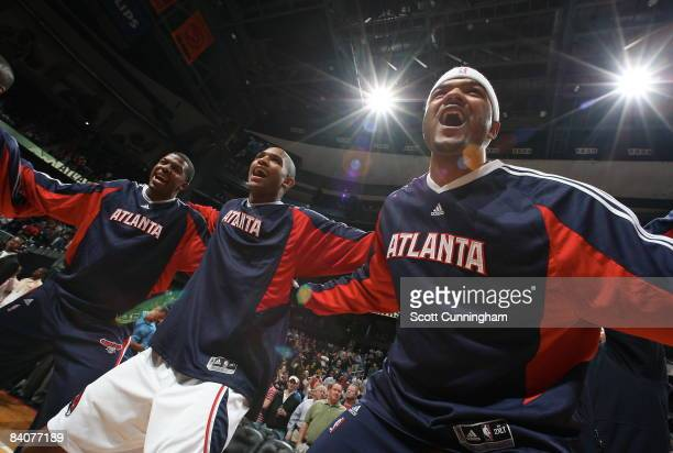 Josh Smith Al Horford and Joe Johnson of the Atlanta Hawks huddle before the game against the Boston Celtics at Philips Arena on December 17 2008 in...