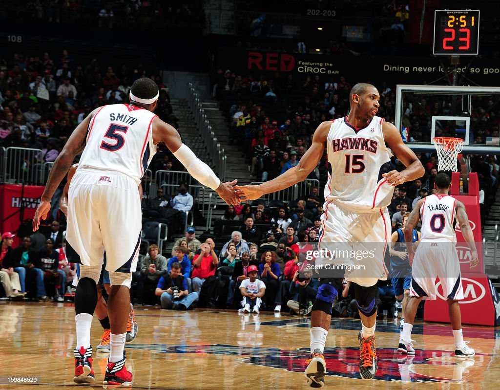 Josh Smith #5 and Al Horford #15 of the Atlanta Hawks celebrate a play in the game against the Minnesota Timberwolves on January 21, 2013 at Philips Arena in Atlanta, Georgia.
