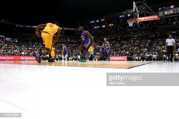 Josh Smith of Bivouac handles the ball against Reggie Evans of 3 Headed Monsters during week four of the BIG3 three-on-three basketball league at...