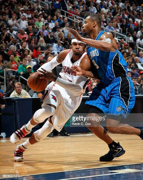 Josh Smith of the Atlanta Hawks against Rashard Lewis of the Orlando Magic at Philips Arena on March 24 2010 in Atlanta Georgia NOTE TO USER User...