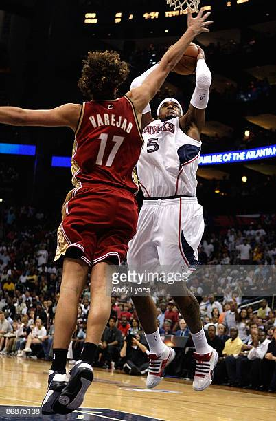 Josh Smith of the Atlanta Hawks attacks the basket against Anderson Varejao of the Cleveland Cavaliers in Game Three of the Eastern Conference...