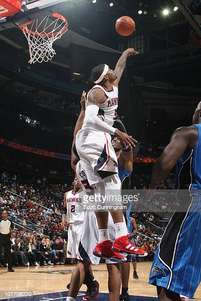 Josh Smith of the Atlanta Hawks blocks the shot of Dwight Howard of the Orlando Magic on December 20 2010 at Philips Arena in Atlanta Georgia NOTE TO...