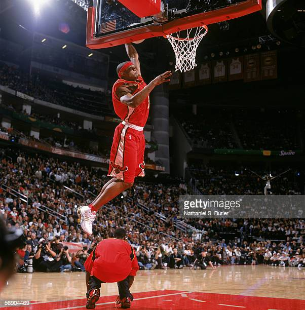 Josh Smith of the Atlanta Hawks completes a dunk as he leaps over Hawks' teammate Royal Ivey during the Sprite Rising Stars Slam Dunk Contest on...