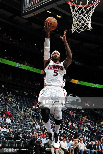 Josh Smith of the Atlanta Hawks drives to the basket against the Charlotte Bobcats at Philips Arena on December 13 2012 in Atlanta Georgia NOTE TO...