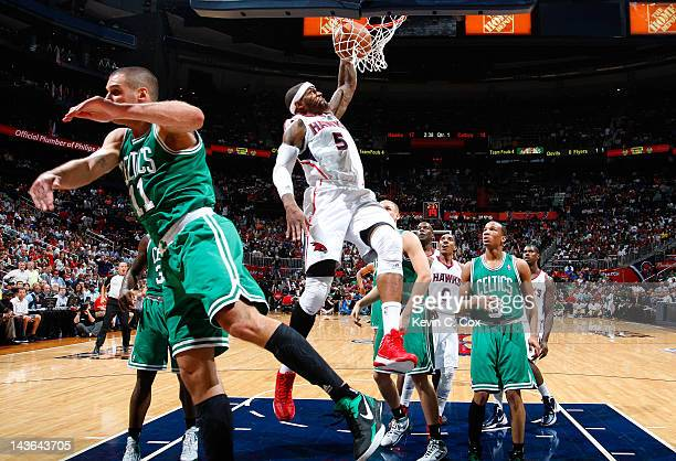 Josh Smith of the Atlanta Hawks dunks against Sasha Pavlovic of the Boston Celtics in Game Two of the Eastern Conference Quarterfinals in the 2012...