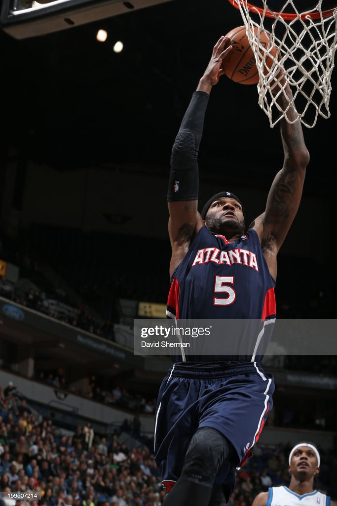 Josh Smith #5 of the Atlanta Hawks dunks against the Minnesota Timberwolves on January 8, 2013 at Target Center in Minneapolis, Minnesota.
