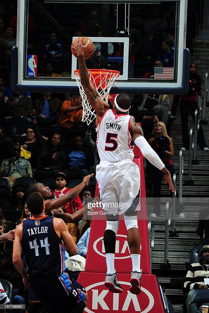 Josh Smith #5 of the Atlanta Hawks dunks the ball against the Charlotte Bobcats at Philips Arena on November 28, 2012 in Atlanta, Georgia.