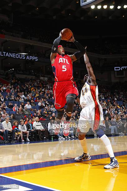 Josh Smith of the Atlanta Hawks fades away on the difficult shot against Anthony Tolliver of the Golden State Warriors on February 21 2010 at Oracle...