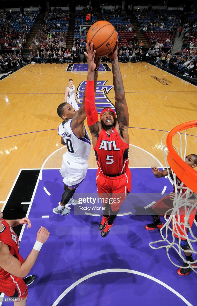 Josh Smith #5 of the Atlanta Hawks grabs the rebound away from Thomas Robinson #0 of the Sacramento Kings on November 16, 2012 at Sleep Train Arena in Sacramento, California.