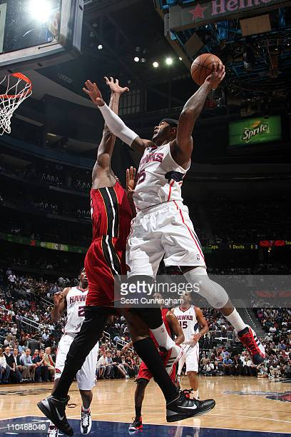 Josh Smith of the Atlanta Hawks shoots against Erick Dampier of the Miami Heat on March 18 2011 at Philips Arena in Atlanta Georgia NOTE TO USER User...