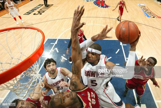 Josh Smith of the Atlanta Hawks shoots against Joe Smith of the Cleveland Cavaliers in Game Three of the Eastern Conference Semifinals during the...