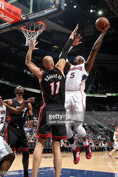 Josh Smith of the Atlanta Hawks shoots against Zydrunas Ilgauskas of the Miami Heat during the game on April 11 2011 at Philips Arena in Atlanta...
