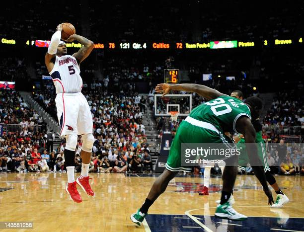 Josh Smith of the Atlanta Hawks shoots over Brandon Bass of the Boston Celtics in Game One of the Eastern Conference Quarterfinals in the 2012 NBA...