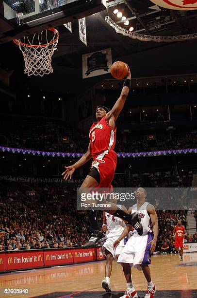 Josh Smith of the Atlanta Hawks soars to the hoop for a dunk against the Toronto Raptors on April 8 2005 at the Air Canada Centre in Toronto Canada...