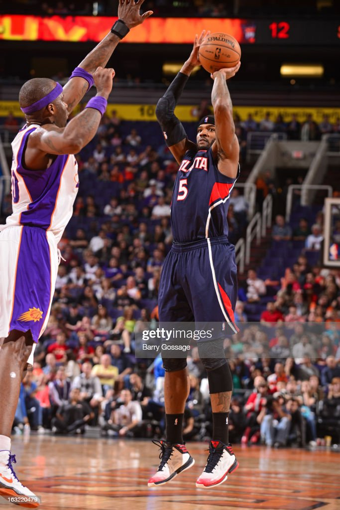 Josh Smith #5 of the Atlanta Hawks takes a shot against the Phoenix Suns on March 1, 2013 at U.S. Airways Center in Phoenix, Arizona.