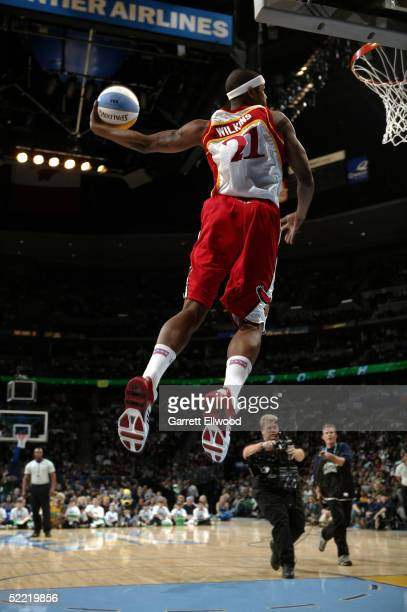 Josh Smith of the Atlanta Hawks wearing a Dominique Wilkins jersey drives for a dunk in the Sprite Rising Stars Slam Dunk Contest during 2005 NBA...