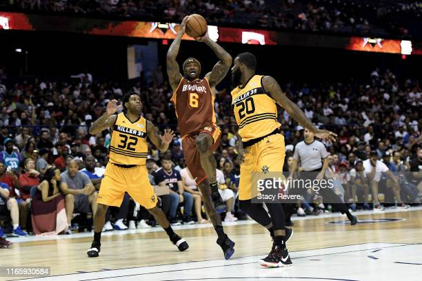 Josh Smith of the Bivouac attempts a shot while being guarded by C.J. Watson and Donte Greene of the Killer 3's in the second half during week seven...