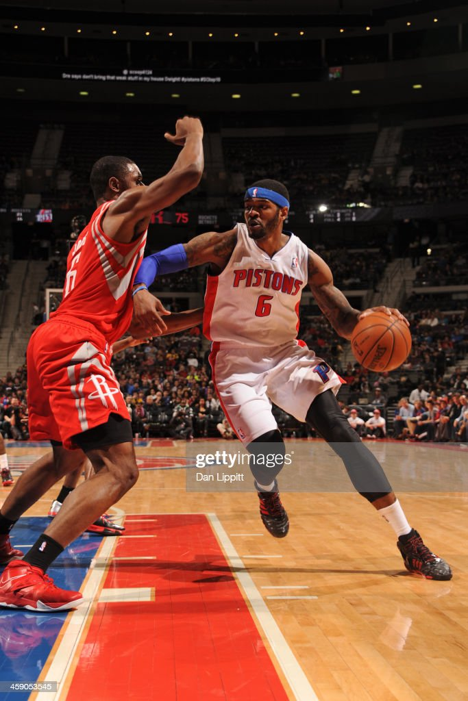 Josh Smith #6 of the Detroit Pistons drives to the basket against the Houston Rockets on December 21, 2013 at The Palace of Auburn Hills in Auburn Hills, Michigan.