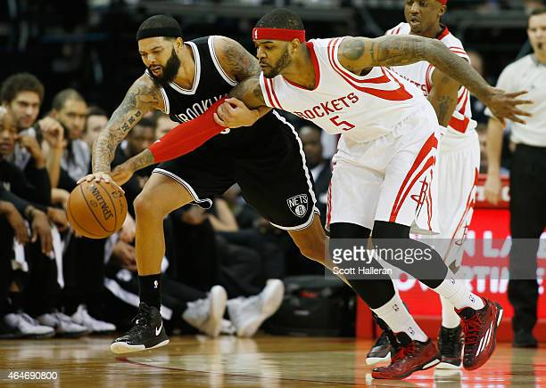 Josh Smith of the Houston Rockets battles for a loose basketball with Deron Williams of the Brooklyn Nets during their game at the Toyota Center on...
