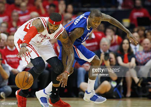 Josh Smith of the Houston Rockets battles for a loose basketball with Jamal Crawford of the Los Angeles Clippers during Game One in the Western...