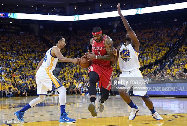 Josh Smith of the Houston Rockets drives on Marreese Speights of the Golden State Warriors but has the ball stripped away by Shaun Livingston in the...