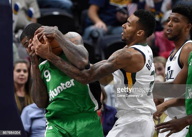 Josh Smith of the Maccabi Haifa fights for the ball with Joel Bolomboy of the Utah Jazz during the second half of the 11778 win by the Jazz in...
