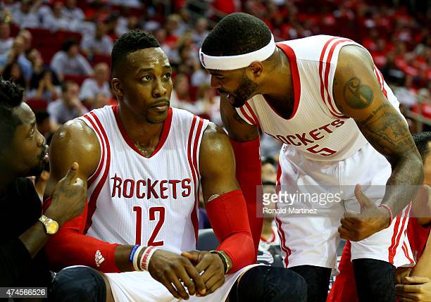 Josh Smith talks to Dwight Howard of the Houston Rockets on the bench in the fourth quarter against the Golden State Warriors during Game Three of...