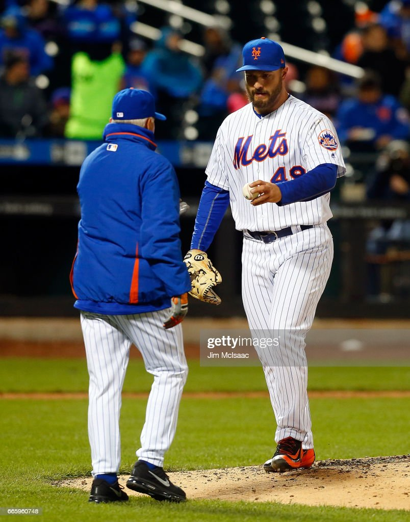 Josh Smoker #49 of the New York Mets hands the ball to manager Terry Collins as he is removed from a game against the Miami Marlins in the fifth inning at Citi Field on April 7, 2017 in the Flushing neighborhood of the Queens borough of New York City.