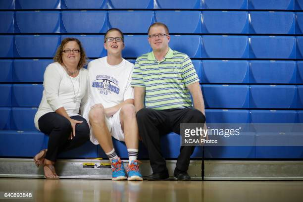 Josh Speidel poses for a portrait with his parents Dave and Lisa in his high school gym in Columbus Ind AJ Mast/ NCAA Photos via Getty Images