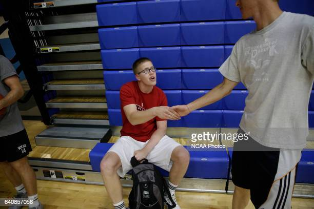 Josh Speidel shoot hoops with his friends Gabe Holt St Francis Brooklyn basketball player Christian Glass Xavier baseball player and Elliott Welmer...