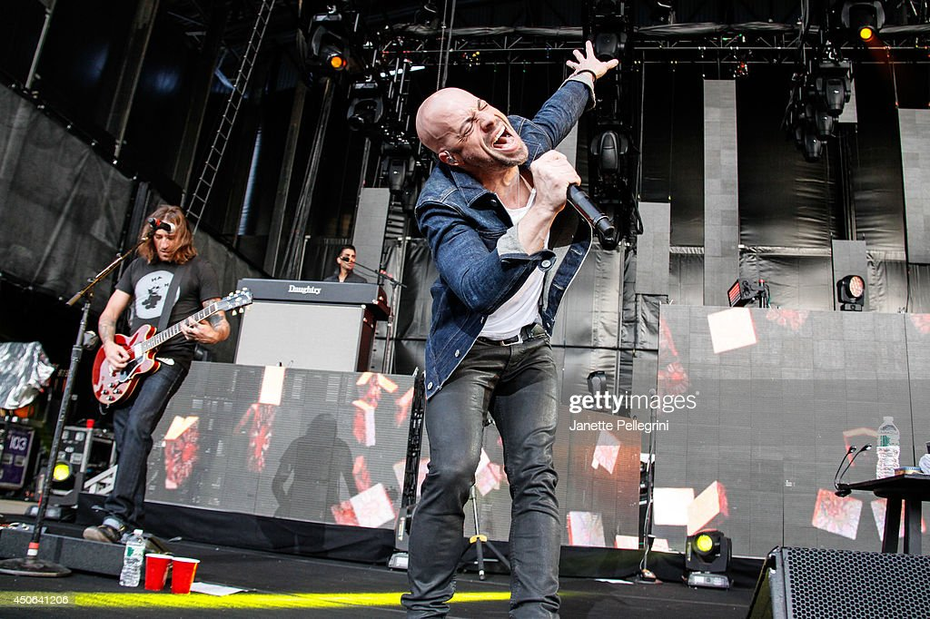 Josh Steely and Chris Daughtry of Daughtry perform in concert at Nikon at Jones Beach Theater on June 14, 2014 in Wantagh, New York.