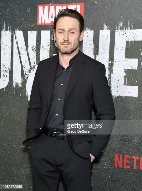 Josh Stewart arrives at Marvel's The Punisher Los Angeles Premiere at ArcLight Hollywood on January 14 2019 in Hollywood California