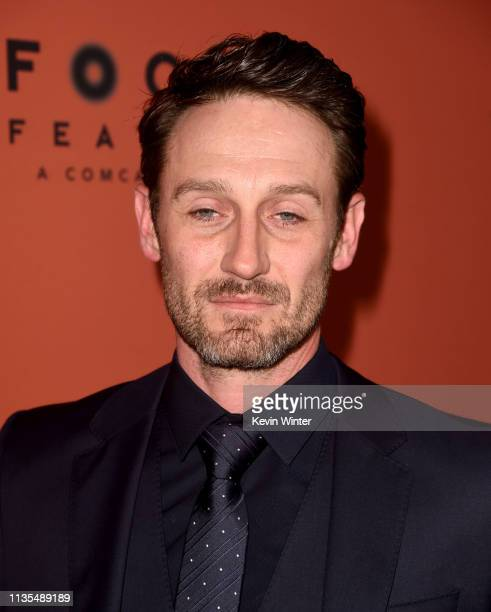 Josh Stewart arrives at the premiere of Focus Features' The Mustang at ArcLight Hollywood on March 12 2019 in Hollywood California