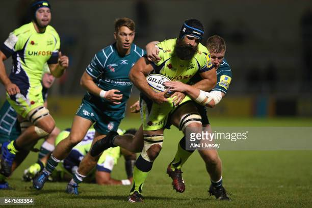 Josh Strauss of Sale Sharks is tackled by Harry Elrington of London Irish during the Aviva Premiership match between Sale Sharks and London Irish at...