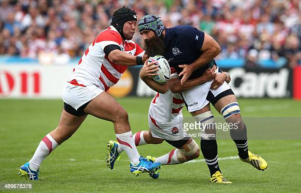 Josh Strauss of Scotland is tackled during the 2015 Rugby World Cup Pool B match between Scotland and Japan at Kingsholm Stadium on September 23 2015...