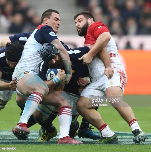 Josh Strauss of Scotland is wrapped up by Louis Picamoles and Rabah Slimani of France during the RBS Six Nations match between France and Scotland at...
