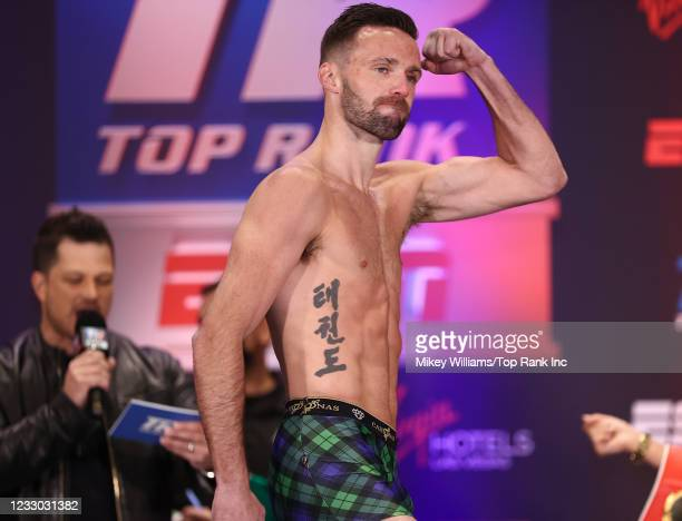 Josh Taylor flexes on the scale ahead of his fight with Jose Ramirez for the Undisputed junior welterweight championship at Virgin Hotels Las Vegas...