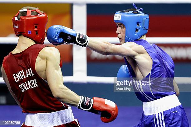 Josh Taylor of Scotland competes against Thomas Stalker of England in the Light Weight Men Finals Gold Medal Bout at Talkatora Indoor Stadium on day...