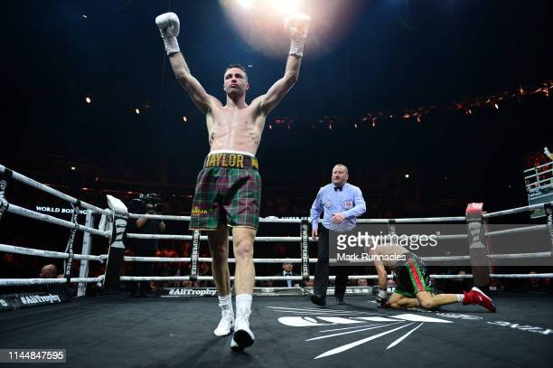 Josh Taylor of Scotland reacts as he knocks down Ivan Baranchyk of Russia during the WBSS Super Lightweight Semi Final IBF World Championship fight...