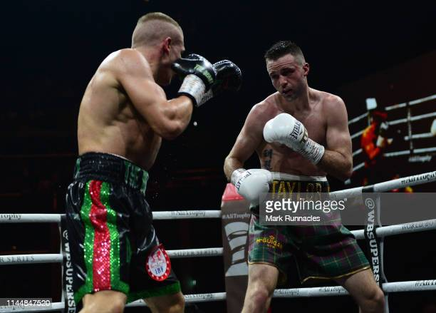 Josh Taylor of Scotland takes on Ivan Baranchyk of Russia during the WBSS Super Lightweight Semi Final IBF World Championship fight at the Muhammad...
