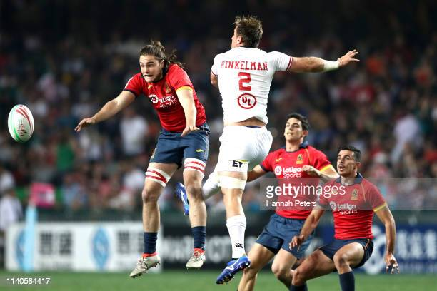 Josh Taylor of Spain competes with Ben Pinkelman of USA for the high ball on day one of the Cathay Pacific/HSBC Hong Kong Sevens at the Hong Kong...